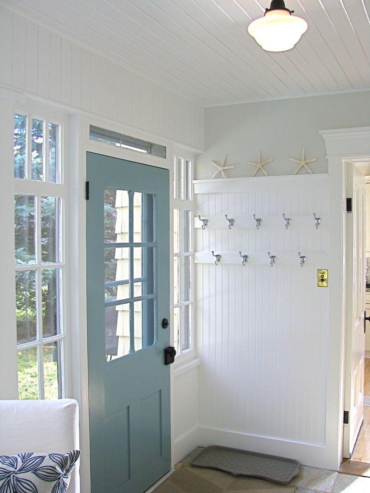 Movies Boca Raton with Traditional Porch  and Black Hardware Blue Back Door Chrome Coat Hooks Mullion Windows Stone Floor White Beadboard Mudroom