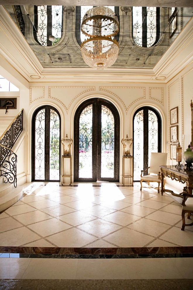 Movies in Boca Raton   Mediterranean Entry Also Arched Doorways Boca Raton Brass Accents Checkered Floor Gold Trim Mirrored Ceiling Scrollwork Traditional Style Wainscotting Wrought Iron Detailing