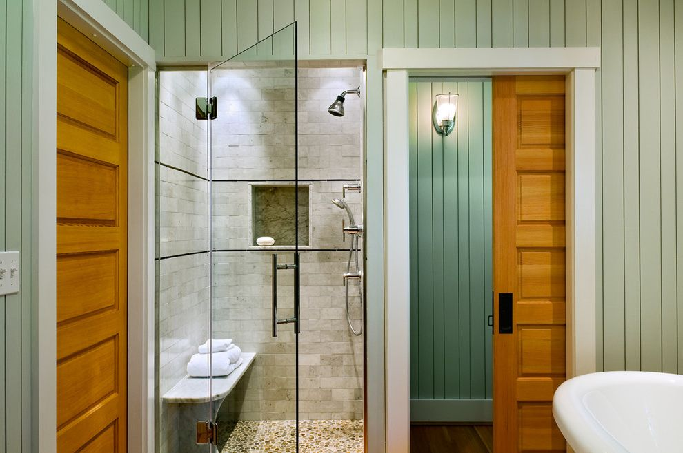 Mr Shower Door with Beach Style Bathroom  and Cottage Glass Door Pebble Tile Pocket Door Rustic Sconce Shower Bench Shower Shelf Sliding Door Sliding Doors Subway Tiles Wall Lighting White Wood Wood Molding Wood Paneling