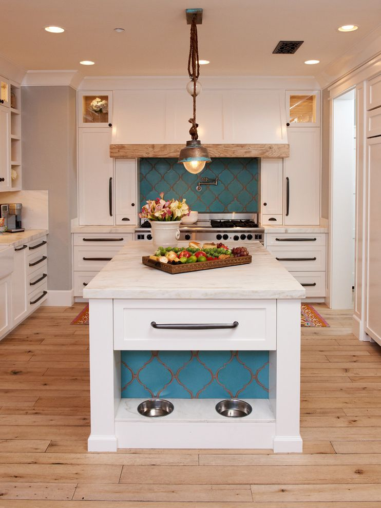 My Dog Keeps Peeing   Mediterranean Kitchen Also Centerpiece Countertop Crown Molding Dog Bowl Glass Cabinet Island L Shaped Kitchen Pantry Pendant Lighting Recessed Lighting Reclaimed Wood Rug Timber Floor Turquoise Backsplash White Cabinets White Trim