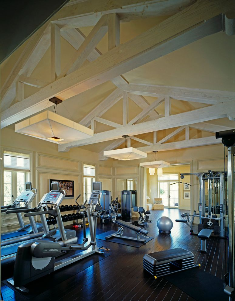 My Gym Cherry Hill   Traditional Home Gym  and Ceiling Lighting Dark Floor Exposed Beams Free Weights Gym Equipment Sloped Ceiling Treadmill Vaulted Ceiling Workout Room