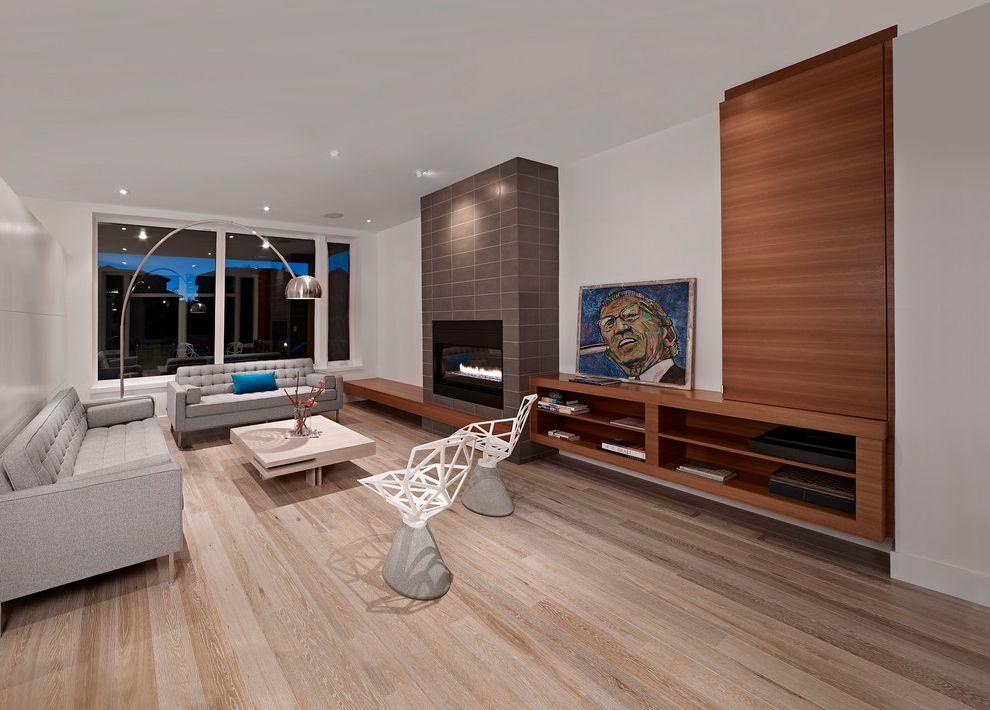 Nailing Hardwood Floors   Contemporary Living Room  and Coffee Table Fireplace Floor Lamp Gray Sofa Modern Sofa Throw Pillow Wall Art White Walls Window Wall Wood Floors Wood Shelves