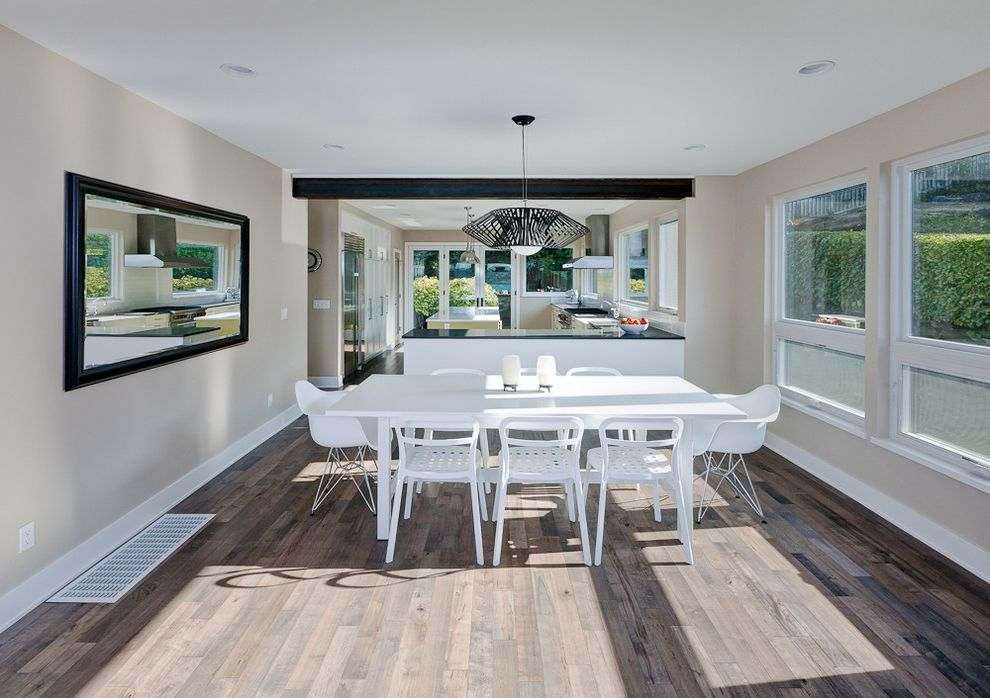Nailing Hardwood Floors with Contemporary Dining Room  and Ceiling Lighting Lantern Minimal Mixed Dining Furniture Modern Light Fixture Neutral Colors Open Kitchen Recessed Lighting White Dining Set White Wood Wood Flooring Wood Trim