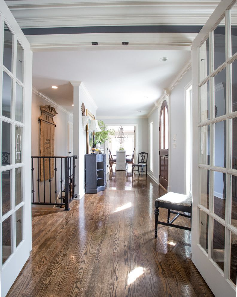 Nailing Hardwood Floors with Traditional Hall Also Airy Arch Front Door Console Decorative Wrought Iron Doorway French Doors Gray Wall Neutral Colors Oak Flooring Recessed Lighting Royer White Trim