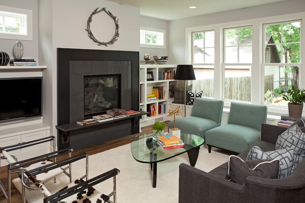 Narrow Accent Chair with Contemporary Living Room  and Black Fireplace Surround Black Lampshade Blue Chairs Built in Bookcase Cowhide Chair Dark Wood Floor Glass Coffee Table Gray Sofa Naguchi Table Wall Mount Tv Wassily Chair White Rug Window Seat