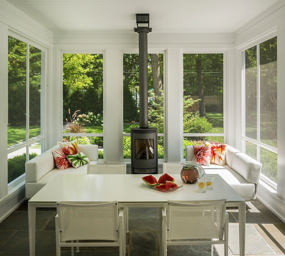 Narrow Stove   Modern Porch  and Backyard Bright Floral Garden Grasses Screened in Porch Slate Floor Sun Porch Sun Room Watermelon White Dining Table White Sectional Sofa Wood Stove