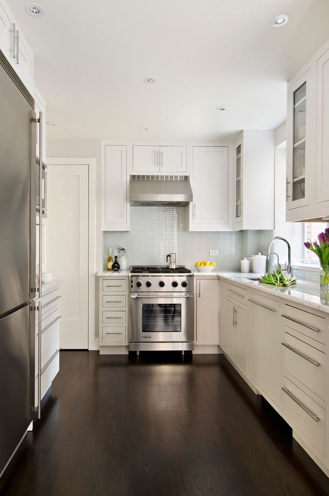 Narrow Stove with Traditional Kitchen  and Glass Cabinet Doors Recessed Lighting White Canisters White Countertop Window Above Sink