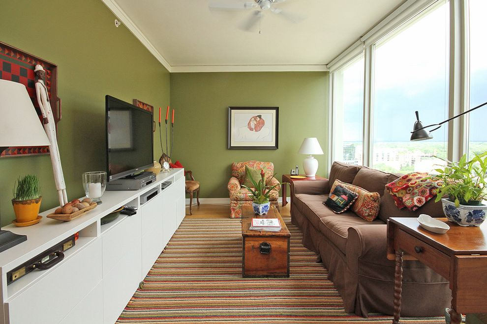 Narrow Tv Stand with Eclectic Living Room  and Area Rug Bright Colors Ceiling Fan Coffee Table Indoor Plants Painted Walls Side Tables Sofa Table Lamp Tv Console Window Walls