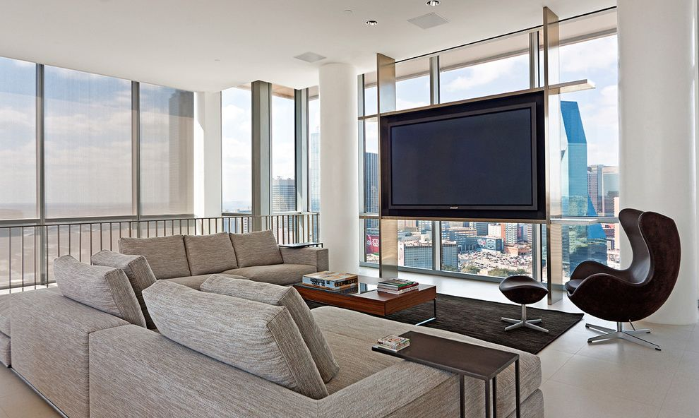 Narrow Tv Stand with Modern Home Theater Also Area Rug City View Coffee Table Column Floor to Ceiing Windows Gray Seating Area Sheer Shades Tv Urban