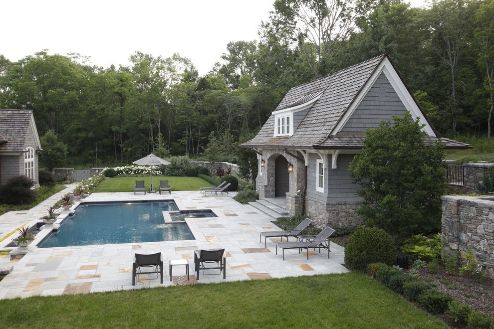 Nashville Pool Company   Traditional Pool Also Arched Doorway Gable Roof Jacuzzi Lanterns Lawn Lounge Chairs Pool House Sauna Shingle Stacked Stone Wall Stone Facade Stone Pool Deck Umbrella