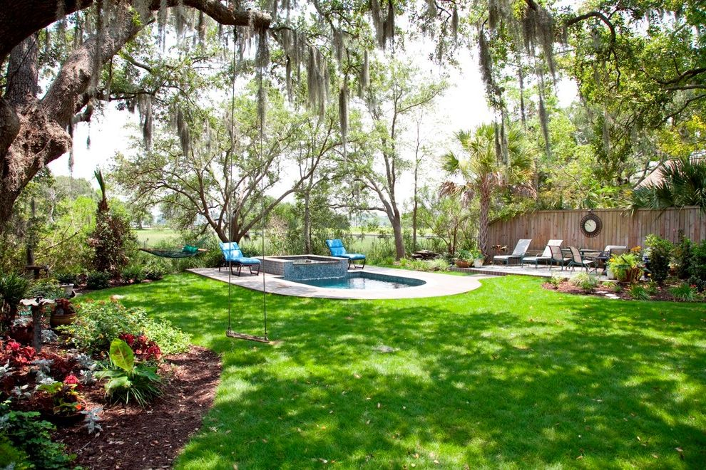 Nashville Pool Company   Traditional Pool  and Backyard Landscaping Backyard Retreat Grass Kids Swing Outdoor Swing Plunge Pool Pool Design Charleston Shade Tolerant Plants Shady Backyard Swimming Pool Design Trees Wood Fence