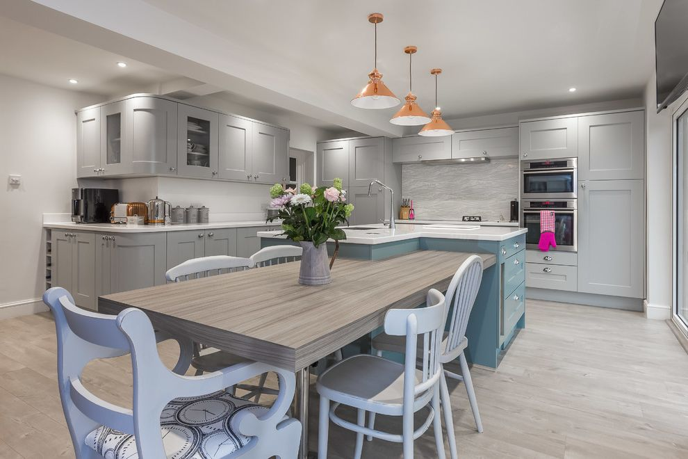 Nassau to Harbour Island   Transitional Kitchen  and Floral Arrangement Gray Grey Island Mounted Table L Shaped Kitchen Island Mix and Match Chairs Painted Kitchen Island Pendant Lights Pitchers