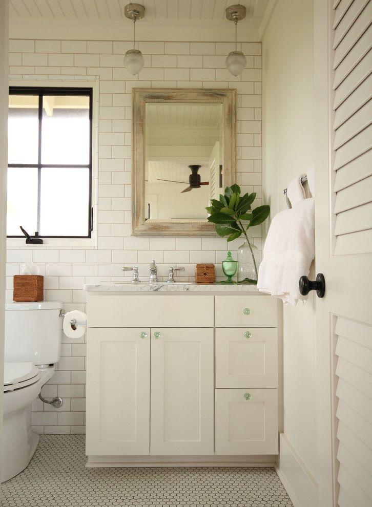 Nch Wellness Center   Beach Style Bathroom Also Black Window Frame Framed Mirror Hex Tile Hexagon Tile Pendnat Light White Bathroom White Countertop