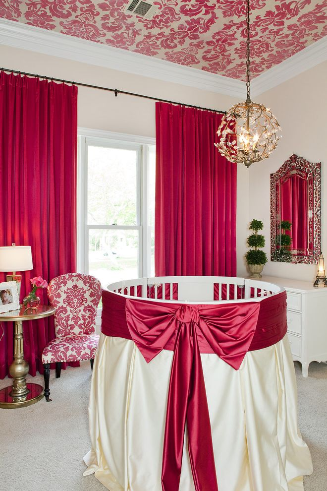 Newborn Baby Girl Pics with Traditional Nursery  and Bedskirt Bows Carpeting Chandelier Crib Curtain Panels Damask Dresser Gold Side Table Nursery Pink Red Satin Upholstered Chair Wallpaper Ceiling White Painted Wood