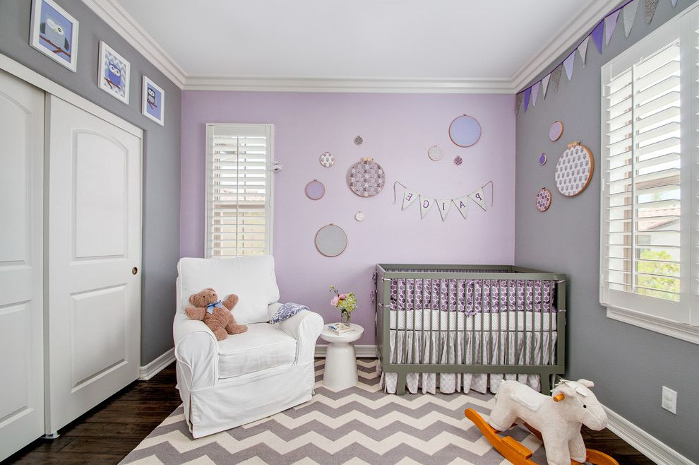 Newborn Baby Girl Pics with Transitional Nursery  and Armchair Baby Bedding Baby Decor Bunting Chevron Rug Grey Pink Purple Modern Crib Owl Decor Rocking Horse Side Table Wall Art