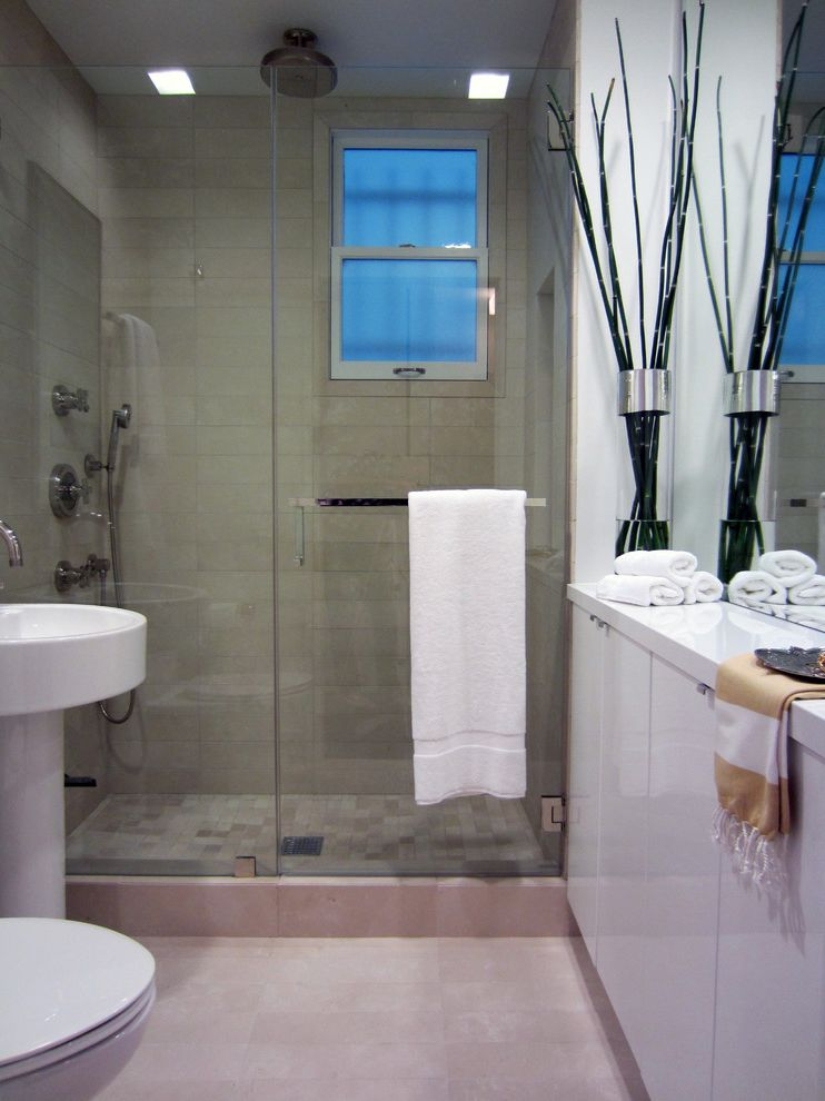 Northwest Shower Door with Contemporary Bathroom Also Bathroom Storage Glass Shower Door Neutral Colors Pedestal Sink Rain Shower Head Shower Window Tile Flooring Towel Bar White Cabinets