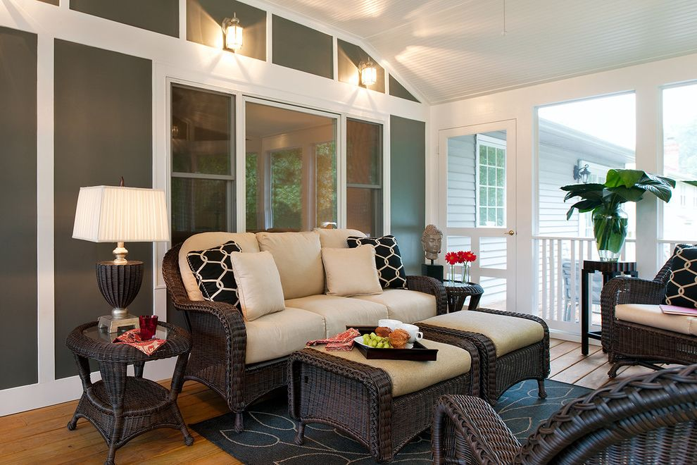 Nu Look Furniture   Eclectic Porch Also Area Rug Ceiling Fan Geometric Pillows Railing Rocking Chairs Sun Room Table Lamps White Seat Cushions Wood Floor Woven Outdoor Furniture Woven Side Tables
