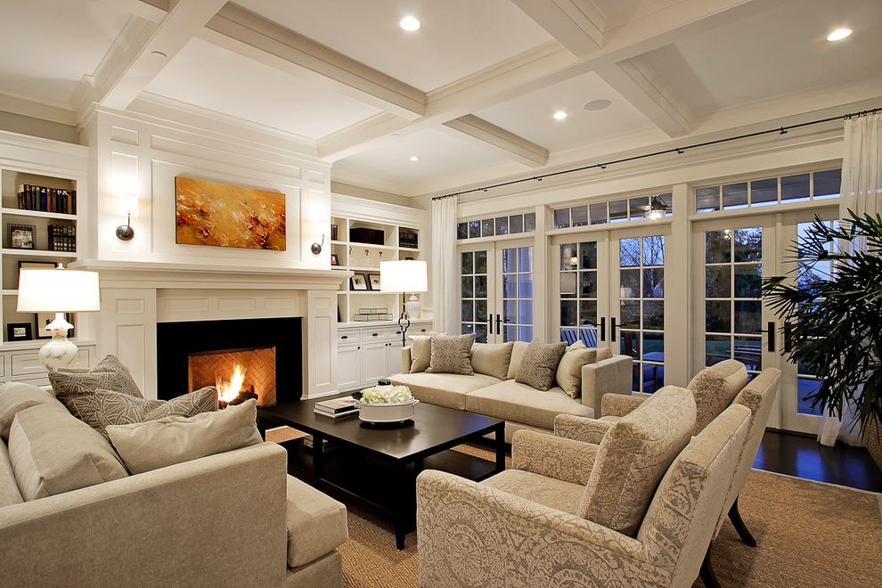 Nu Look Furniture   Traditional Living Room Also Built in Bookshelves Recessed Lights Coffee Table Coffered Ceiling Curtain Panels Dark Stained Wood Floor Fireplace French Doors Seating Area Transom Windows Wood Surround Woven Area Rug