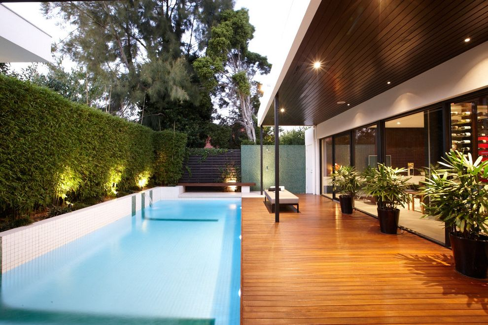 O Connor Pool   Contemporary Pool Also 2 X 2 Tiles Bench Seat Covered Porch Dark Stained Wood Ceiling Floor to Ceiling Windows Hedge Landscape Lighting Lap Pool Outdoor Seating Outdoor Shower Plant Pots Pool Deck Soffit Wood Deck Wood Slat Fence