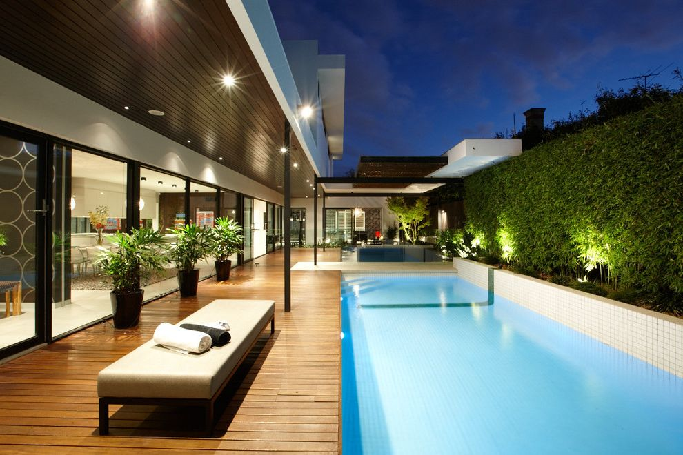 O Connor Pool   Contemporary Pool  and 2 X 2 Tiles Bench Seat Covered Porch Dark Stained Wood Ceiling Floor to Ceiling Windows Hedge Landscape Lighting Lap Pool Outdoor Seating Plant Pots Pool Deck Soffit Wood Deck