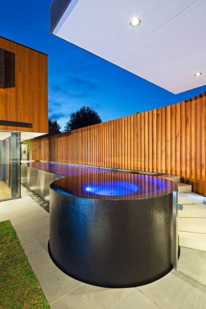 O Connor Pool with Contemporary Pool  and Balance Tank Cedar Circles Circular Concrete Glass Mosaics Melbourne Minimal Minimalist Modern Mondo Negative Edge Plant Pot Pool Steppers Wet Edge