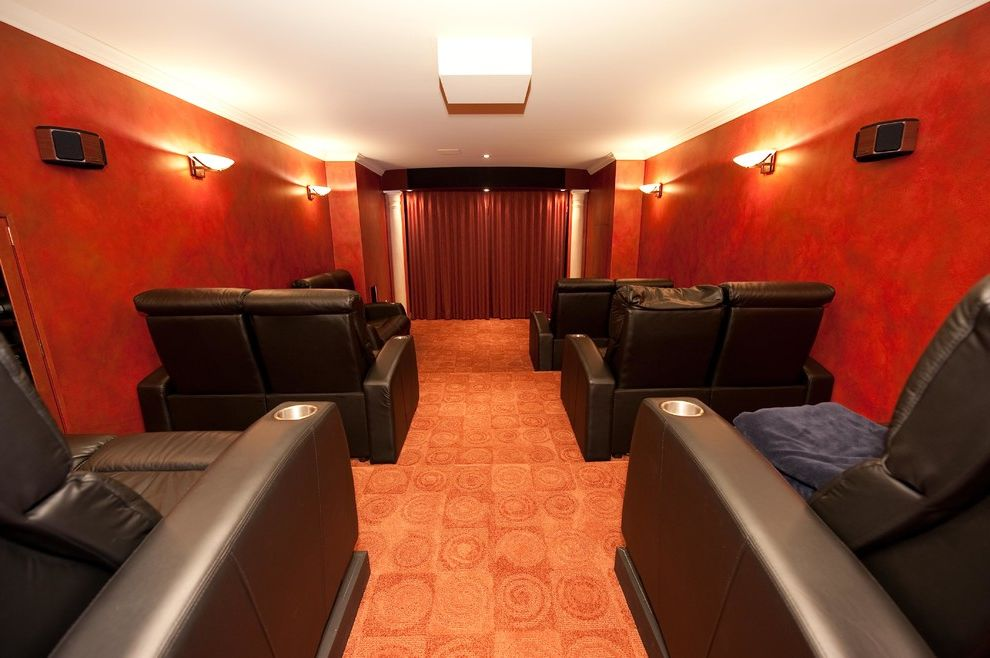 Oakwood Theater   Traditional Home Theater  and Basement Bathroom Design Hardwood Floors Home Theater Renovation Shower Staricase