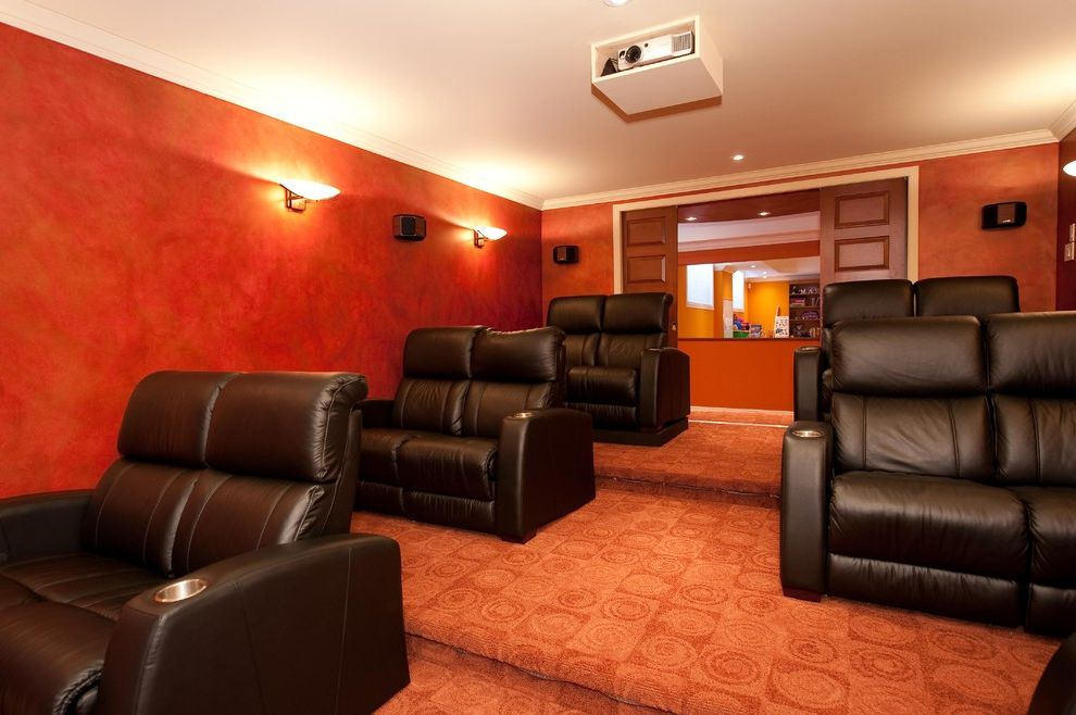Oakwood Theater with Traditional Home Theater  and Basement Bathroom Design Hardwood Floors Home Theater Renovation Shower Staricase