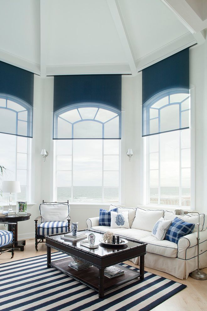 Octagon Window Blinds   Contemporary Family Room  and Arched Windows Area Rug Blue Dark Stained Wood Floor Lamp Muntins Natural Wood Floor Nautical Navy Ocean Octagon Piping Plaid Sheer Navy Roller Blind Stripes Water View White Upholstery
