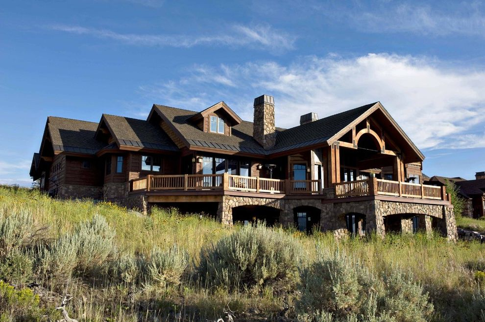 Odyssey House of Utah   Rustic Exterior Also Balcony Bead and Board Exterior Deck Dormer Windows Field Hillside Patio Ranch Ranch Style Home Rock Columns Rural Rustic Home Stone Chimney Timbers View Walkout Basement