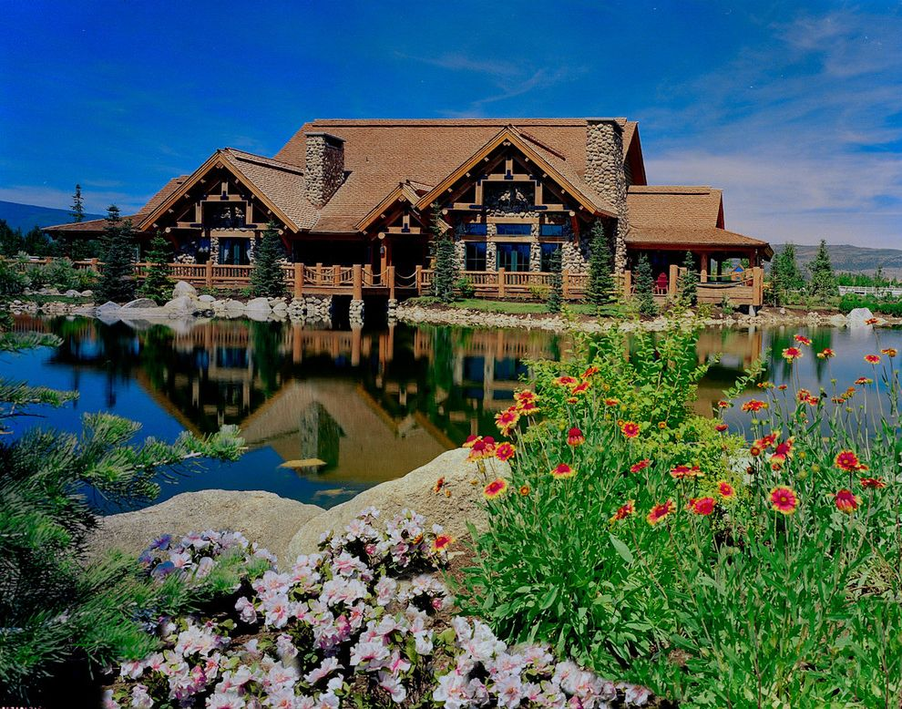 Odyssey House of Utah with Rustic Exterior  and Boulders Cabin Lake Rocks Rustic Stone Wall View Waterfront
