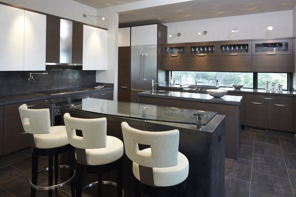Off White Bar Stools with Modern Kitchen Also Concrete Island Flush Cabinets Glass Counter Glass Front Uppers Gray Walls Halogen Lights Hood Kitchen Island Stainless Steel Appliances Tile Floor White Cabinets White Counter Stools