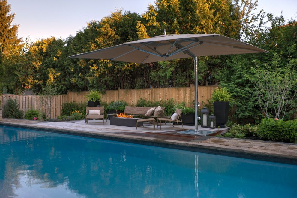 Offset Umbrella with Base with Contemporary Pool Also Big Pool Black Planters Fire Pit Ipe Wood Landscape Design Landscaping Outdoor Furniture Outdoor Seating Rectangular Pool Stone Patio Wood Deck Wood Fence