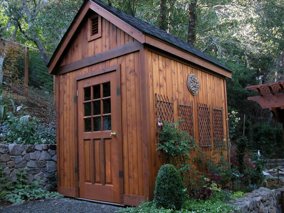 Old Hickory Buildings and Sheds   Traditional Shed  and Cable Railing Dark Stained Wood Gable Roof Garden Shed Gravel Hillside Landscaping Medallion Pergola Rock Wall Tongue and Groove Siding Tool Shed Trellis
