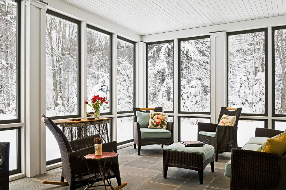 One Way Window Screen   Farmhouse Porch  and Board Ceiling Enclosed Porch Indoor Outdoor Patio Furniture Pavers Porch Stone Floor Sun Sunroom View Wicker Furniture Winter
