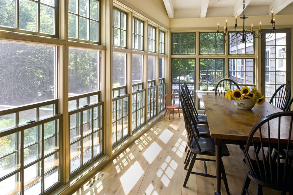 One Way Window Screen   Traditional Dining Room  and Chandelier Dining Table Double Hung Windows Farm Table Green Painted Trim Knotty Pine Rafters Spindle Chairs Sun Room White Painted Wood Ceiling Wood Floor