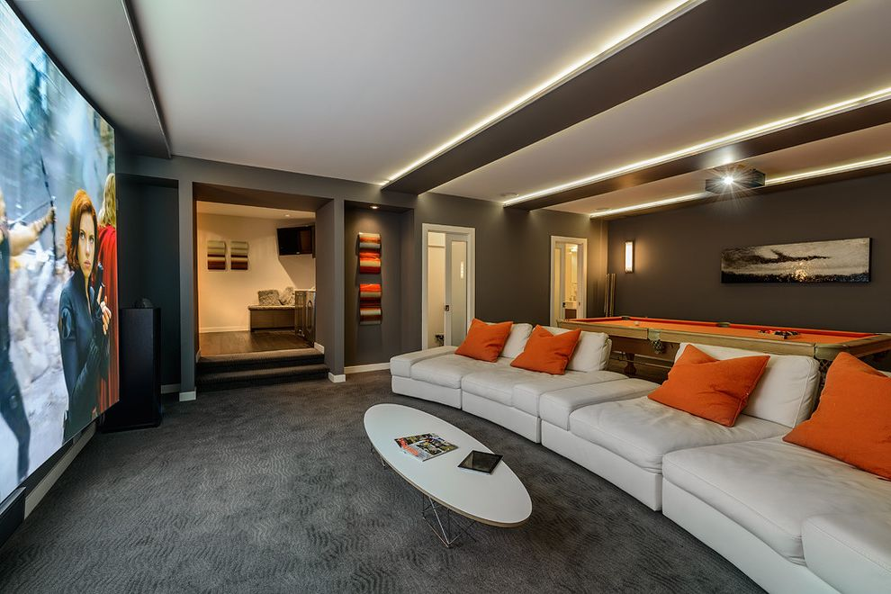 Orange Park Theater   Contemporary Home Theater Also Billiards Carpet Ceiling Lighting Dark Wall Doorway Family Room Game Room Home Theater Orange Cushions Oval Coffee Table Pool Table Projection Screen Projector Sconce Sofa Steps Wall Art