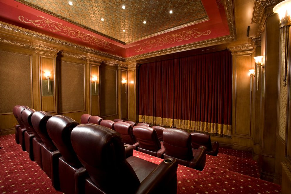 Orange Park Theater   Mediterranean Home Theater  and Cove Ceiling Crown Molding Home Theater Leather Armchairs Gold Recessed Lights Red Screening Room Theater Drapery Theater Seating Velvet Wall Panelling Wall Sconces