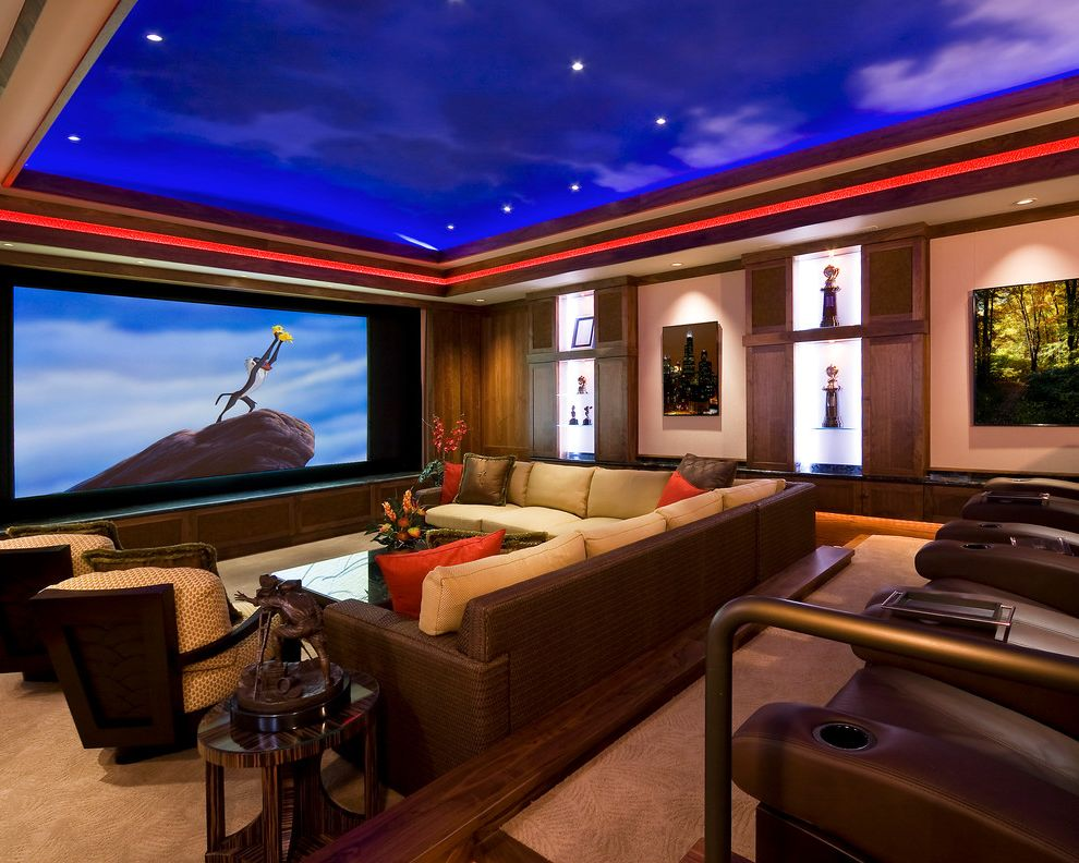 Orange Park Theater   Traditional Home Theater Also Ambient Lighting Carpet Ceiling Treatment Cup Holders Home Theater Leather Chairs Neutral Recessed Lighting Side Table Sofa Wall Shelves