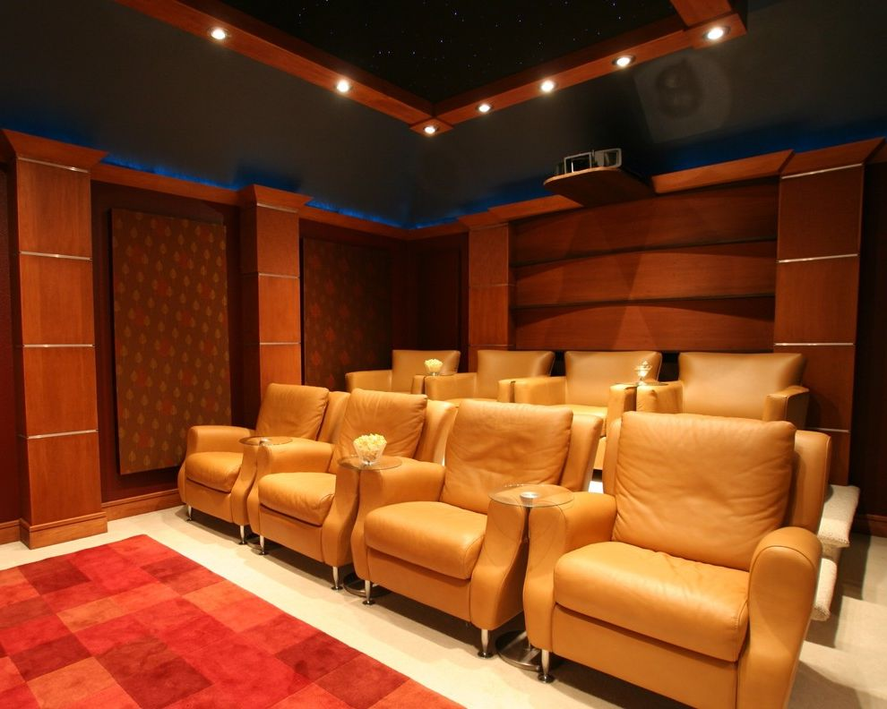 Orange Park Theater   Traditional Home Theater Also Carpet Home Theater Home Theatre Leather Armchair Projector Recessed Lighting Red Rug Sound Proof Terraced Seating Theater Seating Theatre Seating Wood Panelling