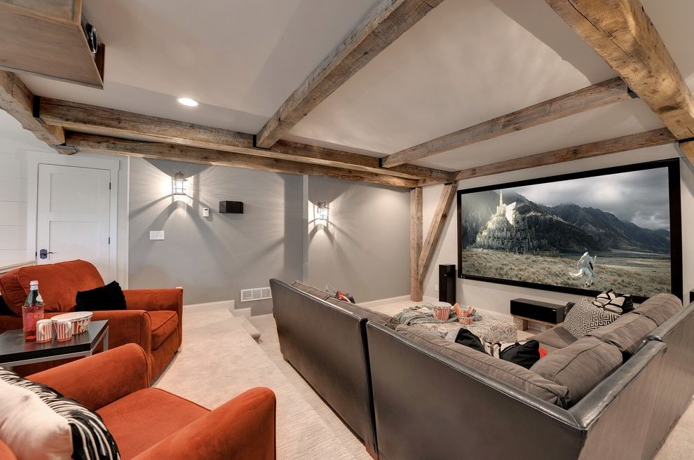 Orange Park Theater   Transitional Home Theater Also Basement Beam Ceiling Beamed Beamed Ceiling Beams Light Gray Walls Movie Theater Orange Sofa Rustic Wood Beams Sectional Sofa Theater Theater Seating Wall Sconces