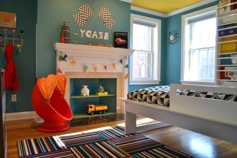 Orange Theory Buckhead   Contemporary Kids Also Bed Blue Paint Blue Wall Bookcase Fireplace Modern Modern Bed Rug Wood Floor Yellow Ceiling