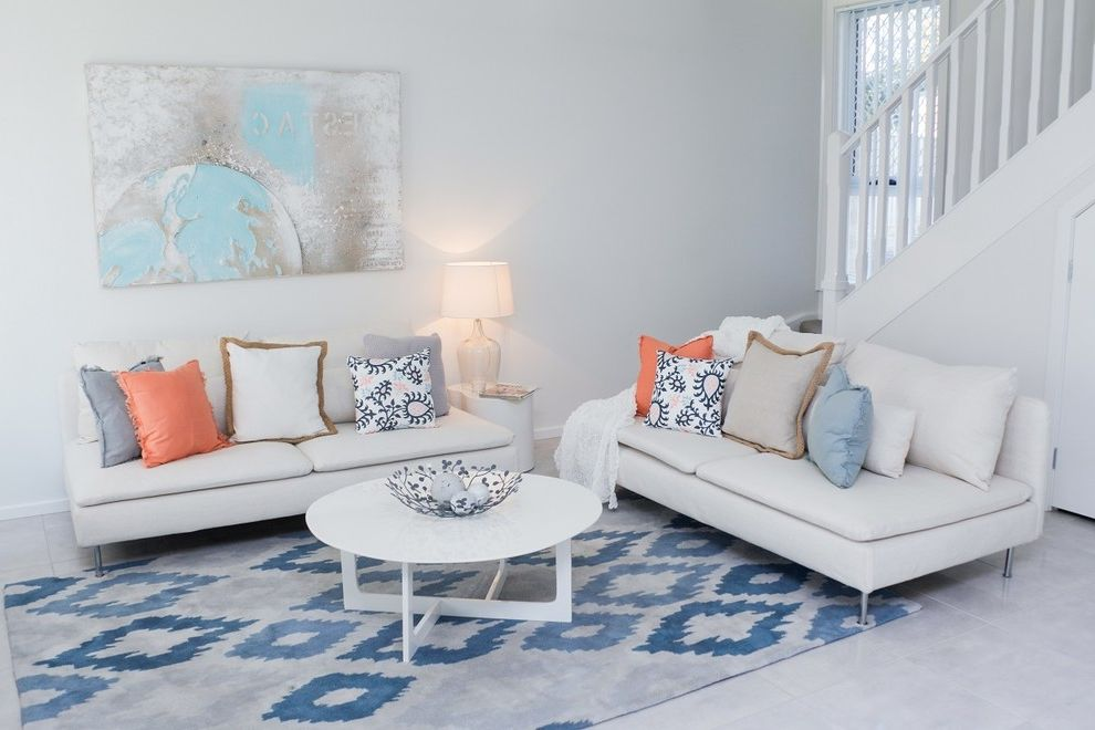 Orange Theory Buckhead with Transitional Living Room  and Defense Housing Ikat Rug Multi Unit Development Nelson Bay Nsw Orange Pillow Skillion Roof Two Storey Townhouse White and Blue White Couches World Art