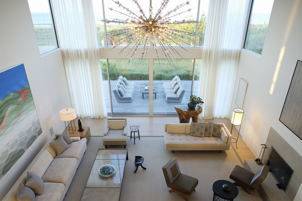 Orb Chandelier Lowes with Modern Living Room Also Area Rug Artwork Chandelier Deck Fireplace Grasses Lounge Furniture Marble Neutral Tones Outdoor Seating Area Tall Windows White Curtains Window Treatment Wood Floor