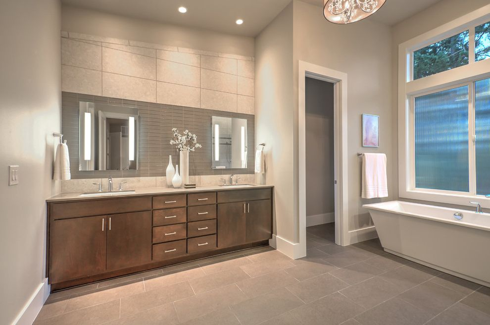 Oregon Tile and Marble with Contemporary Bathroom  and Artwork Clerestory Windows Gray Ceiling Gray Countertop Gray Floor Tile Gray Glass Tile Gray Walls Metal Cabinets Rippled Glass Textured Glass Towel Bar Towel Rings Two Sinks White Trim White Vases
