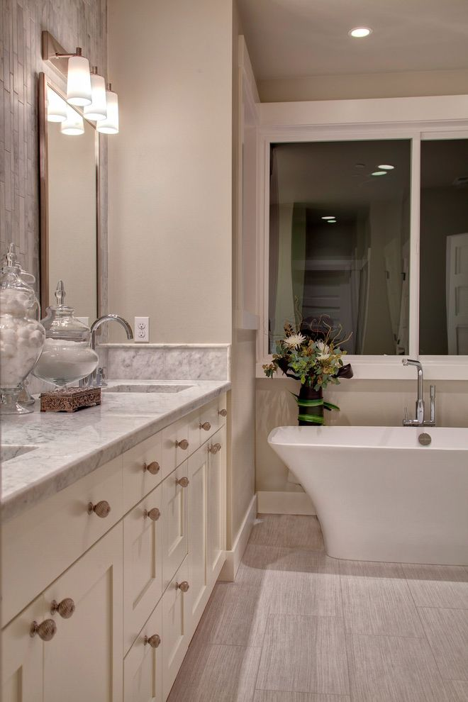 Oregon Tile and Marble with Contemporary Bathroom  and Free Standing Tub Grey Marble Bath Master Bath Shaker Vanity Cabinet Square Sinks Tile Behind Mirrors Vertical Tile Victoria and Albert White