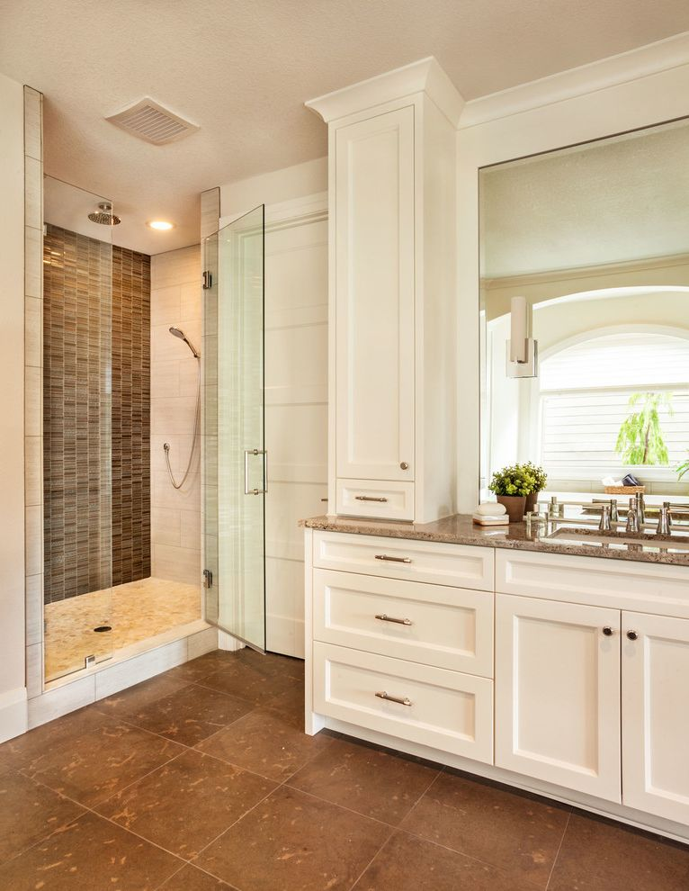 Oregon Tile and Marble with Transitional Bathroom Also Brown Countertop Brown Floor Tile Built in Mirror Handshower Rain Shower Head Recessed Light in Shower Wall Sconce Widespread Faucet