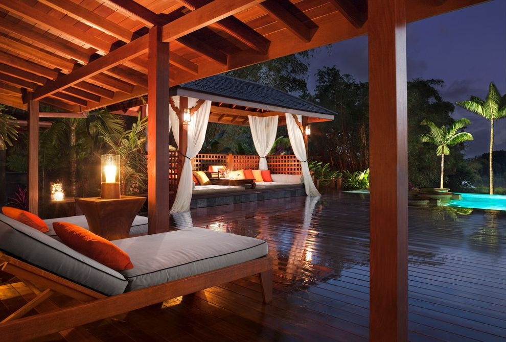 Outdoor Cabana Bed   Tropical Deck  and Bali Balinese Cabana Covered Outdoor Spaces Deck Lanai Large Overhang Lattice Outdoor Living Palm Trees Pavilion Pool Tropical Tropical Architecture Wooden Deck Wooden Lounge Chair Wooden Patio