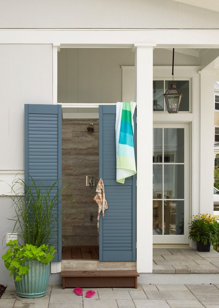 Outdoor Door Knobs with Beach Style Patio  and Blue Shower Door Gas Lanterns Glass Door Horizontal Tile Louvered Door Louvered Shutters Outdoor Shower Planter Square Columns Transom Transom Window White Columns White Painted Wood