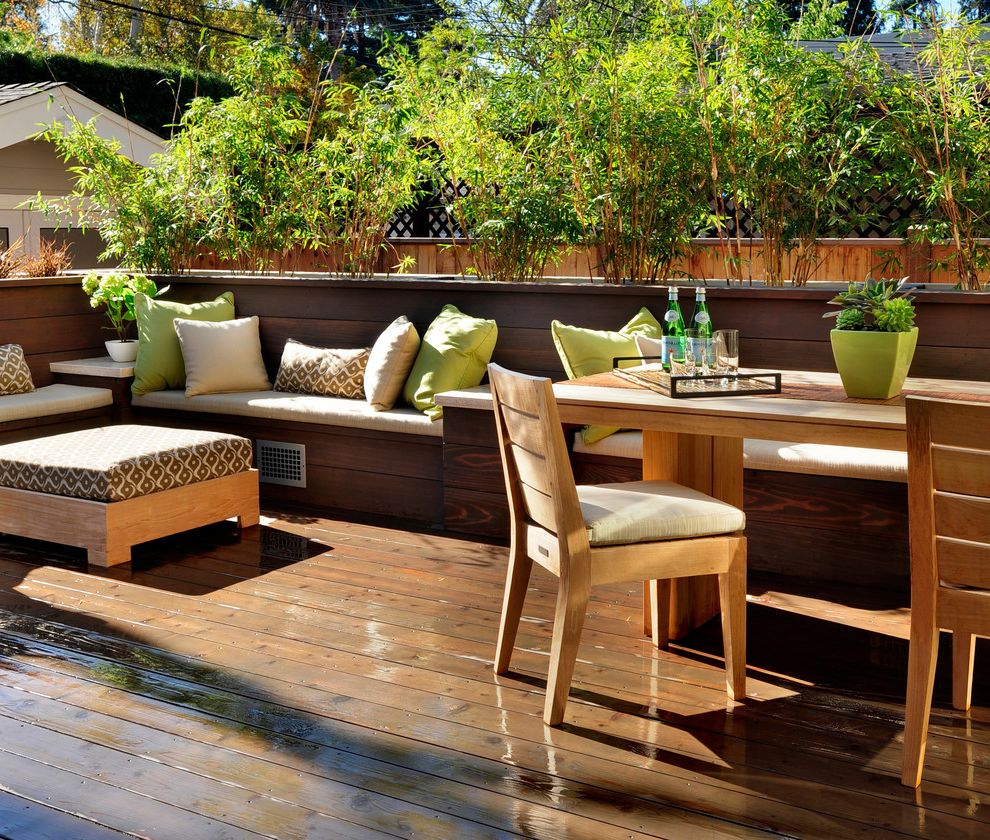 Outdoor Griddle Built in   Contemporary Deck Also Built in Seating Deck Decorative Pillows Horizontal Slat Fence Neutral Colors Outdoor Cushions Outdoor Dining Patio Furniture Planters Throw Pillows Wood Flooring