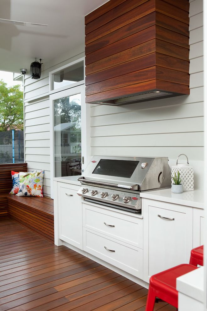 Outdoor Griddle Built in with Transitional Patio  and Deck with Built in Bench Floral Throw Pillows Glass Door Outdoor Built in Bbq Red Metal Stools White Perimeter Countertop White Shiplap Siding